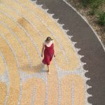 Student walking the labyrinth in George Square