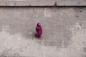 Woman in purple Sari walking