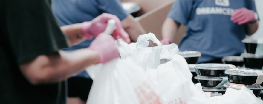 Food Bank Workers Packing Plastic Bags