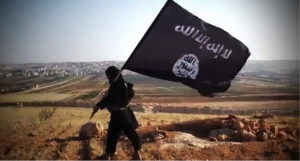 Figure 3: ISIS fighter with Islamic State flag (redstate.com)