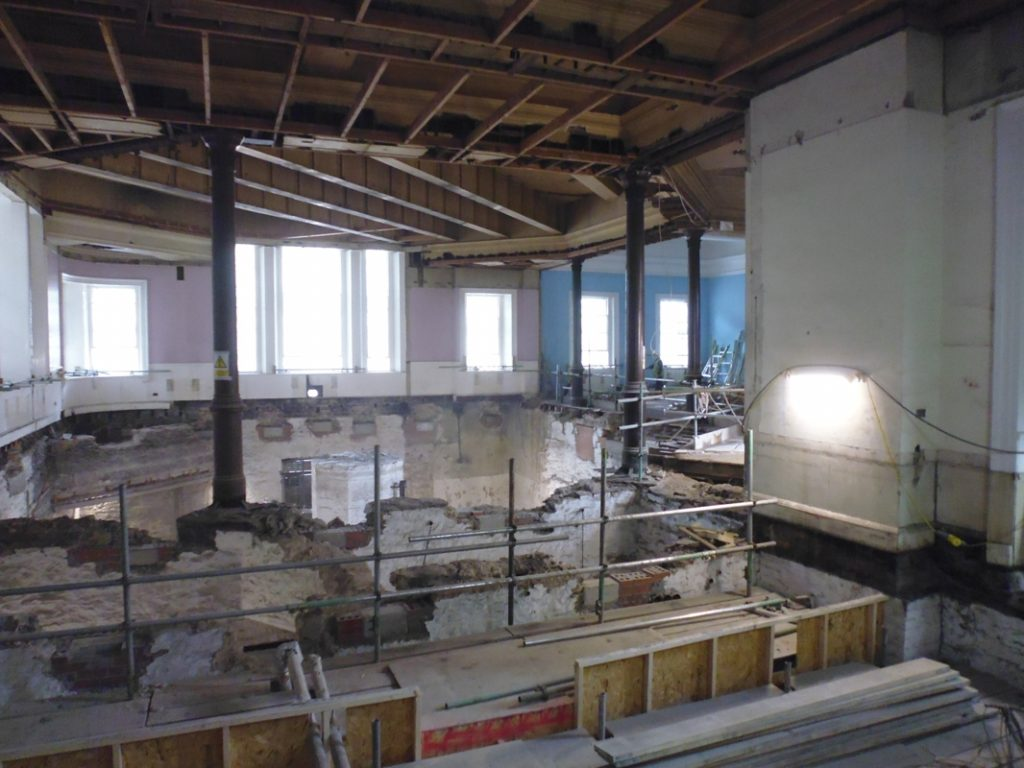 View of the ongoing works to restore the original octagonal architecture of the northwest corner, which will become the octagonal bookstacks in the new library.